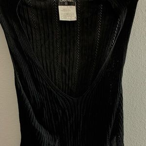 CHANEL black knit sleeveless blouse.